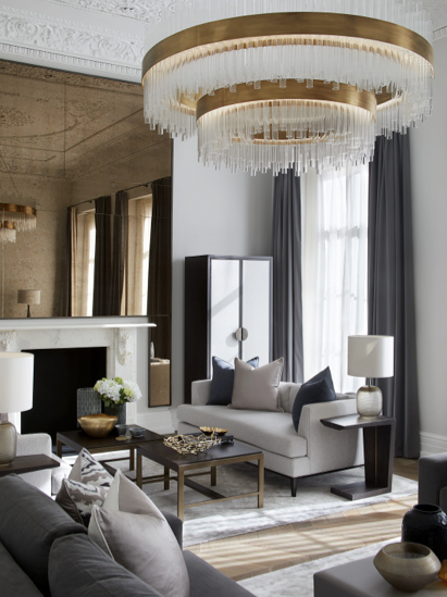 Grand gold and glass light and pale gold and beige living room
